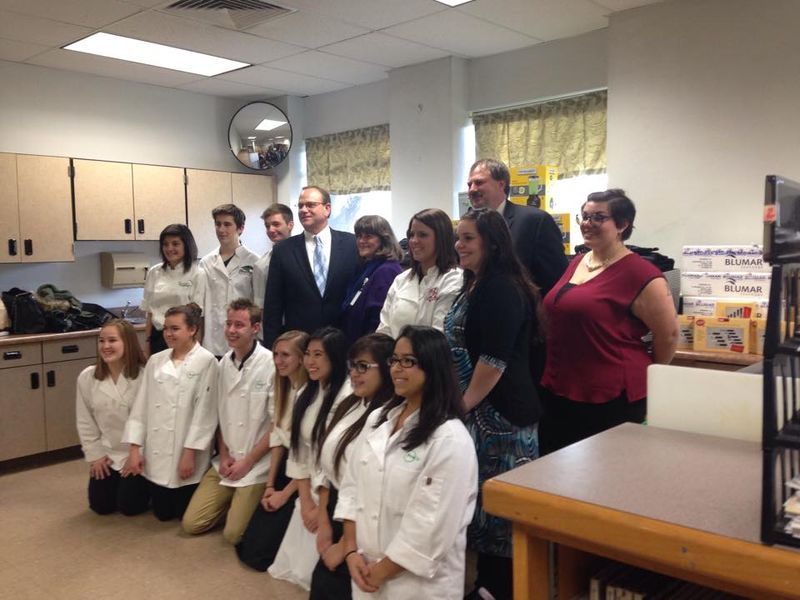 Prostart Students & Teachers with Superintendent and Buddy Lahl with donations behind them