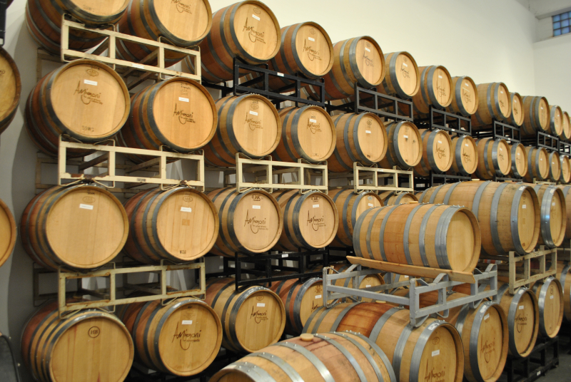The tall ceilings allow for them to stack their wine barrels up to almost the rafters of their new space