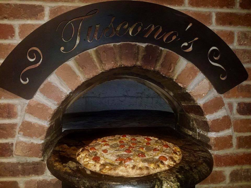 Back home at Tuscono's in Buckner  they are selling their competition winner called The Award Winner for $22 with Italian sausage  roasted yello peppers  mozzarella and ricotta cheese and peppadew peppers