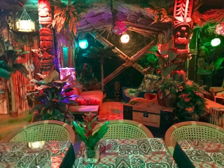 Bamboo Ben a tiki bar artisan was brought in to do the build out of this basement space inside of HopCat