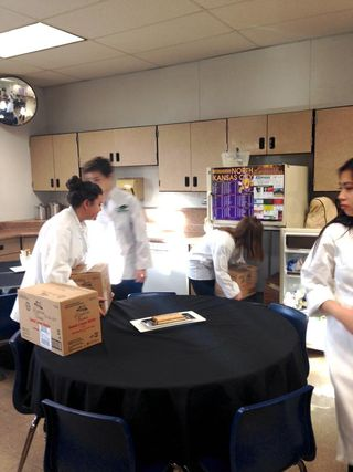 ProStart Students putting away the food stuff donations