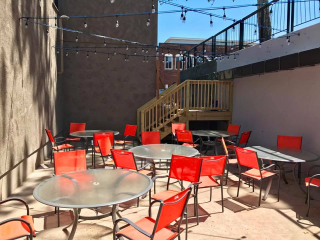 The outdoor deck is located from the lower level bar